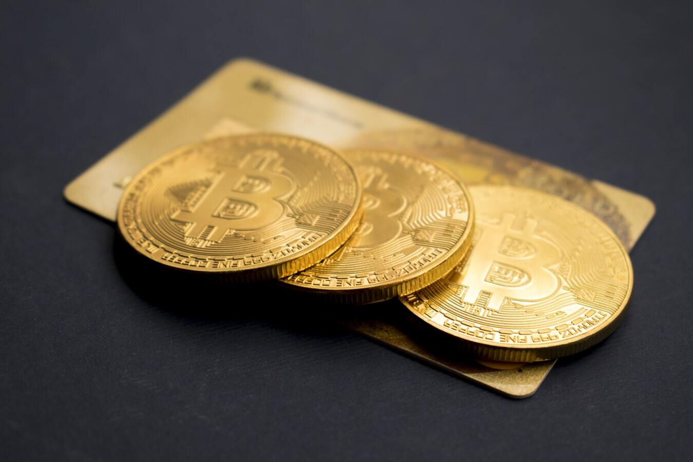 three-bitcoins-on-golden-card-aboutus-page